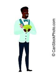 Happy african-american groom holding money.