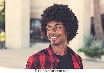 Happy african american hipster man with afro hairstyle