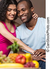 happy African American man and woman. Couple in their...