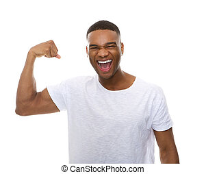 Close up portrait of a happy african american man flexing arm muscle
