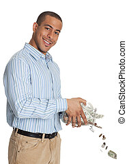 Happy African American man pouring money through jar