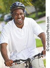 Happy African American Man Riding Bike Smiling