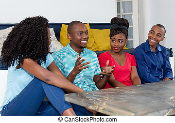 Happy african american people talking about sports and politics