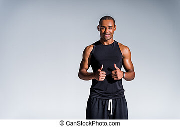 happy african american sportsman showing thumbs up