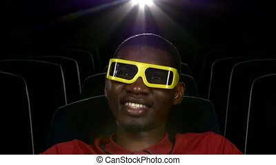 Happy African American watching movie In theatre. 3D stereo glasses. comedy Film