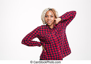 Happy african american woman in checkered shirt