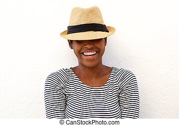 Happy african american woman laughing with hat