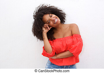Happy african american woman leaning with head on hand
