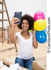 Happy African American woman taking a selfie