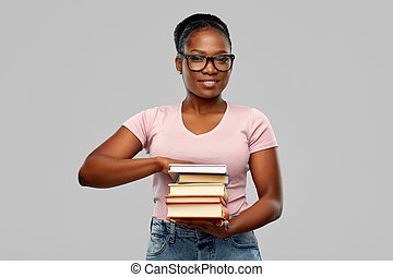 happy african american woman with books