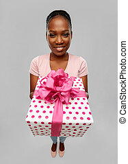 happy african american woman with gift box