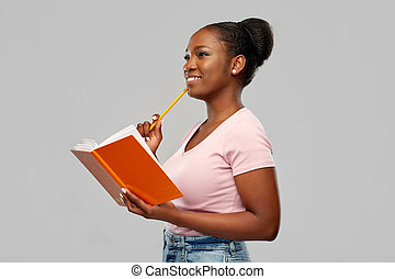 happy african american woman with notebook