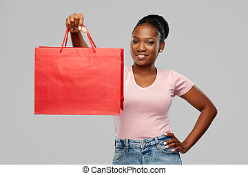 happy african american woman with shopping bag