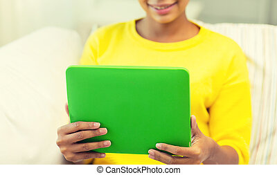 happy african american woman with tablet pc