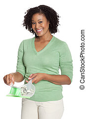 African American young woman cleaning up banknotes with dustpan
