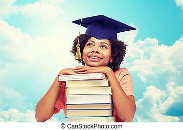 happy african bachelor girl with books over sky