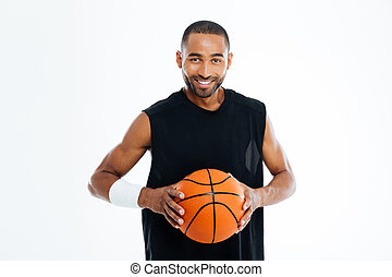 Happy african basketball player standing with ball