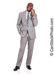 african businessman talking on mobile phone
