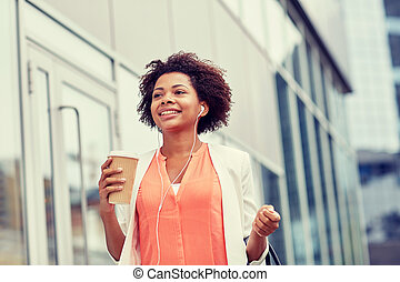 happy african businesswoman with coffee in city - business ...