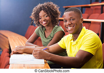 african college classmates in lecture hall - happy african...