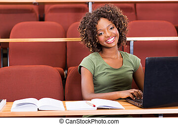 african college girl using laptop
