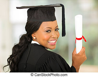 african college graduate looking back - happy african...