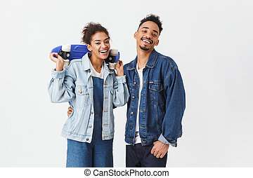 Happy african couple in denim shirts posing together