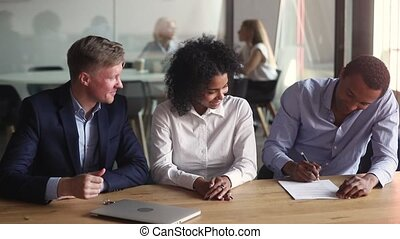 Happy african american couple make real estate deal sign mortgage bank loan investment contract meeting realtor, black first time home buyers renters property owners handshake agent get new house key