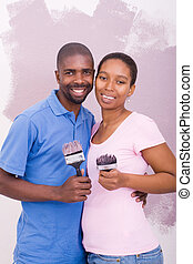 happy african couple painting
