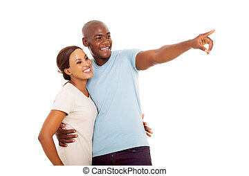 african couple pointing