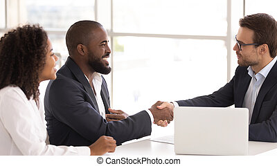 Happy african couple shake hand of insurer buy insurance services