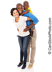 african family of three piggybacking