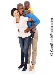 african family of three piggybacking