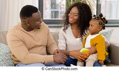 happy african family with baby daughter at home