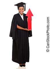 african female graduate holding red arrow