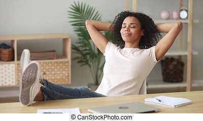 Happy african girl finished work take deep breath of air -...