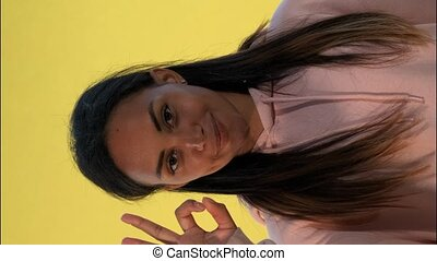 Happy african girl showing okay hand gesture and thumps up. Video with Vertical Screen Orientation 9:16
