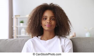 Happy african girl talking to camera make skype video call -...