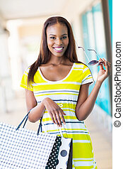 happy african girl with shopping bags