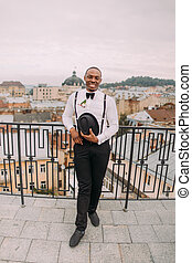 Happy african groom smiling on the rooftop