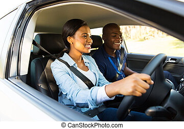 african learner driver taking lessons