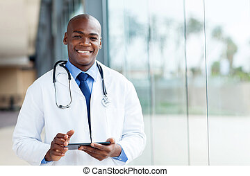 african male doctor - happy african male doctor with tablet...