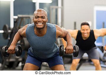 african man exercising in gym