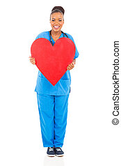 african nurse holding heart - happy african nurse holding...