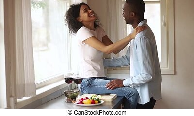 Happy african romantic young couple having fun embracing in...