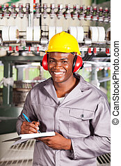 happy african textile factory worker