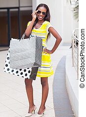happy african woman in shopping center