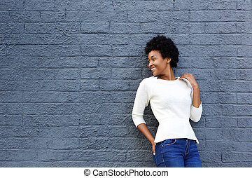 Happy african woman looking at copy space