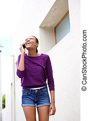 Happy african woman making a phone call