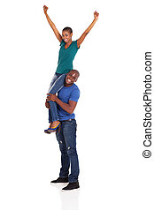 happy african woman sitting on her boyfriend's shoulder
